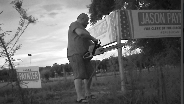 The Lake County Sheriff's Office is looking for this man who was caught on camera using a chain saw to cut down a large 3-post political sign in Tavares, Florida. (Lake County Sheriff's Office)