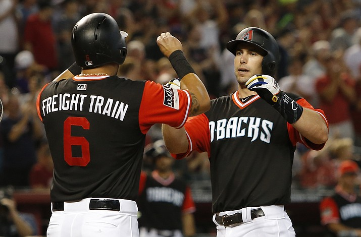 Arizona Diamondbacks' Paul Goldschmidt celebrates with David Peralta (6) after hitting a three-run home run against the Seattle Mariners in the third inning during a baseball game, Sunday, Aug. 26, 2018, in Phoenix. (Rick Scuteri/AP Photo)