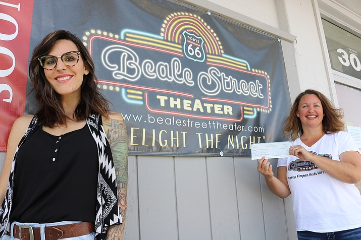 Lory Bowers (left) presented a $600 check to Kristina Michelson and the Beale Street Theater in August. Local photographer donates to Beale Street Theater. (Photo by Travis Rains/Daily Miner)