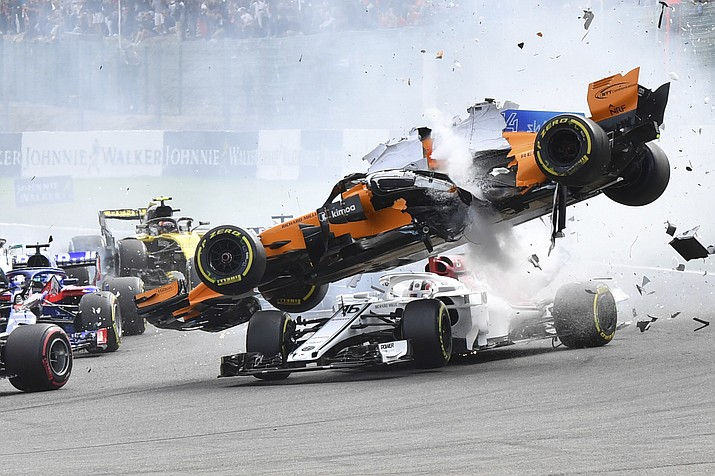 Mclaren driver Fernando Alonso of Spain, top, goes over the top of Sauber driver Charles Leclerc of Monaco as they are involved in a crash at the start of the Belgian Formula One Grand Prix in Spa-Francorchamps, Belgium, Sunday, Aug. 26, 2018. (Geert Vanden Wijngaert/AP Photo)