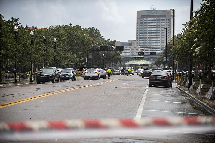 Police barricade a street near the Jacksonville Landing in Jacksonville, Fla., Sunday, Aug. 26, 2018. Florida authorities are reporting multiple fatalities after a mass shooting at the riverfront mall in Jacksonville that was hosting a video game tournament. (Laura Heald/AP Photo)