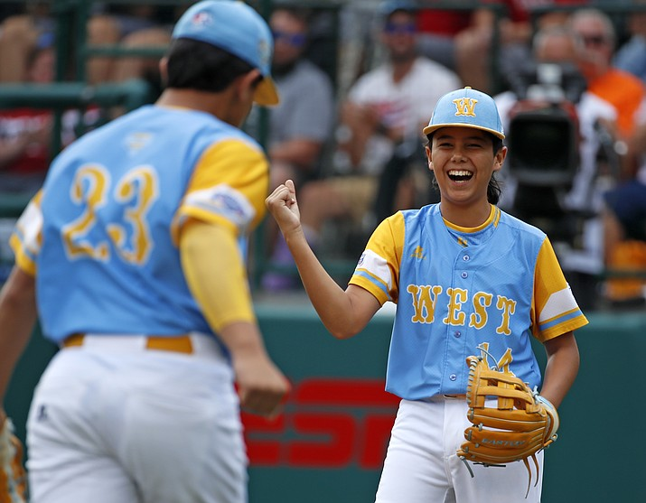 Honolulu, Hawaii pitcher Ka'olu Holt (14) celebrates with teammate Aukai Kea (23) after getting the final out of the first inning of the Little League World Series Championship baseball game against South Korea in South Williamsport, Pa., Sunday, Aug. 26, 2018. (Gene J. Puskar/AP Photo).