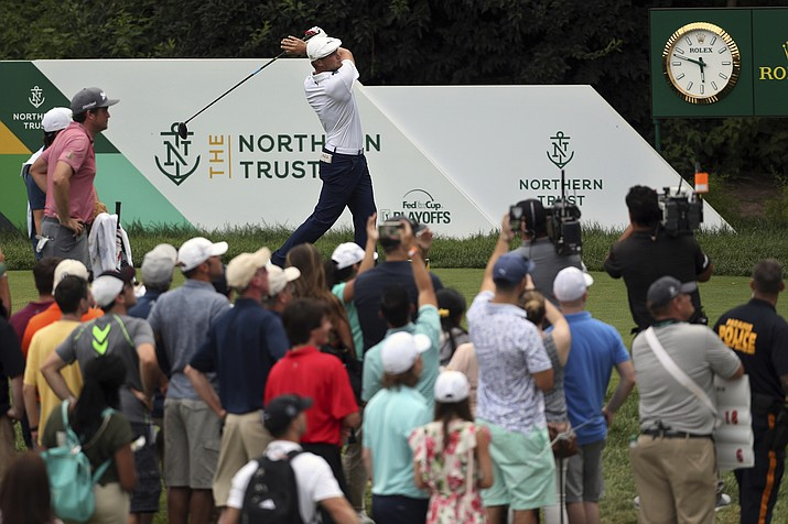 Bryson DeChambeau, top center, hits his tee shot on the 18th hole during the final round of the Northern Trust golf tournament, Sunday, Aug. 26, 2018, in Paramus, New Jersey. DeChambeau won the tournament. (Mel Evans/AP Photo)