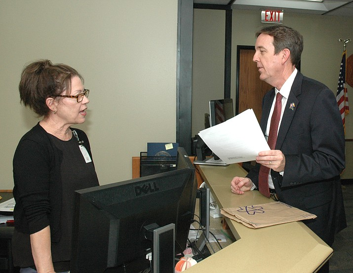 Gubernatorial hopeful Ken Bennett delivers a summons late Friday to Kari Benz at the Secretary of State's Office for a hearing Monday on his attempt to get more time to get $5 donations to qualify for public funding for his campaign. (Capitol Media Services photo by Howard Fischer)