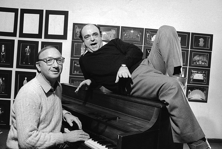 """In this Nov. 23, 1981, file photo playwright Neil Simon, left, and actor James Coco pose for a photo in New York during the New York announcement of a Broadway bound musical comedy, """"Little Me."""" Simon, a master of comedy whose laugh-filled hits such as """"The Odd Couple,"""" """"Barefoot in the Park"""" and his """"Brighton Beach"""" trilogy dominated Broadway for decades, died on Sunday, Aug. 26, 2018. He was 91. (AP Photo/Lederhandler, File)"""
