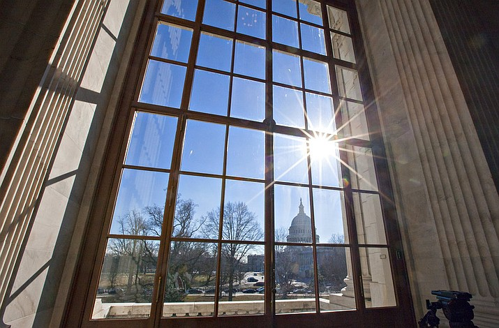 In this Jan. 27, 2014 file photo, the Capitol is seen from the Russell Senate Office Building on Capitol Hill in Washington. A proposal to rename the Russell Senate Office building after Arizona Sen. John McCain appears to be gaining bipartisan support, but success is far from assured. Senate Democratic leader Chuck Schumer proposed renaming the Senate's oldest office building in McCain's honor after the veteran Republican senator died Aug. 25, 2018, from brain cancer. (AP Photo/J. Scott Applewhite, File)