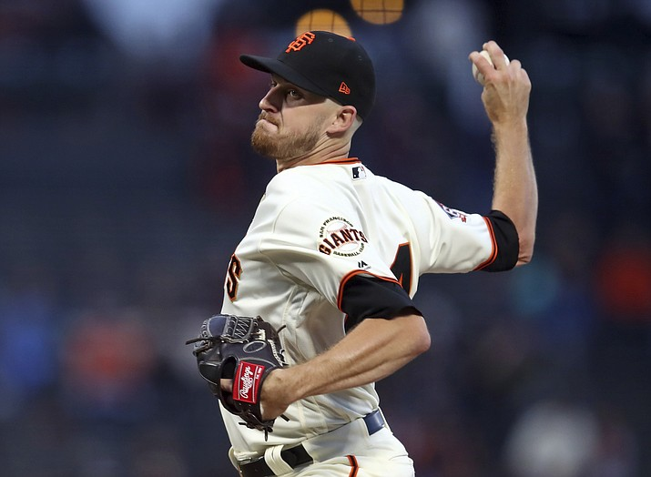 San Francisco Giants pitcher Chris Stratton works against the Arizona Diamondbacks in the first inning of a baseball game Monday, Aug. 27, 2018, in San Francisco. (Ben Margot/AP Photo)