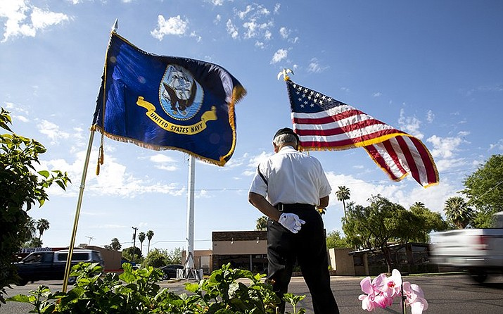 POW MIA KIA Honor Guard Commander David Carrasco on Sunday stands outside the A.L. Moore-Grimshaw Mortuaries Bethany Chapel in Phoenix, where Sen. John McCain's body was moved to Saturday night. (Photo by Anya Magnuson/Cronkite News)