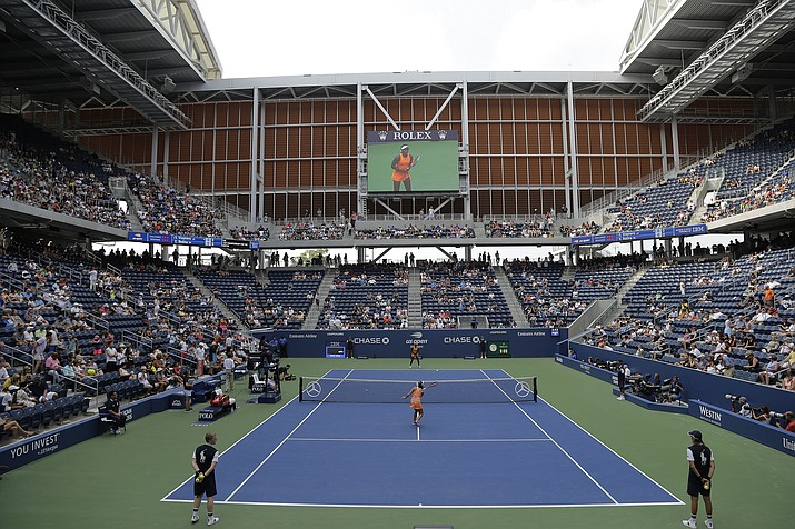 Evgeniya Rodina, of Russia, foreground, and Sloane Stephens warm-up to play in Louis Armstrong Stadium during the first round of the U.S. Open tennis tournament, Monday, Aug. 27, 2018, in New York. (Julio Cortez/AP Photo)