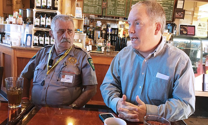 Camp Verde Town Manager Russ Martin, pictured at right with volunteer police officer Tim Wiggle, explains that he will do preliminary interviews this week to fill the Town Marshal opening. VVN/Bill Helm
