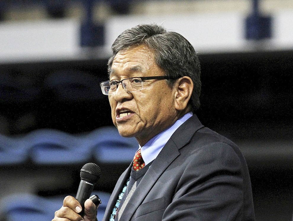 FILE - In this May 12, 2015, file photo, Navajo Nation President Russell Begaye gives his inaugural speech at Fighting Scouts Events Center in Fort Defiance, Ariz. Navajo voters have a record number of candidates to choose from in the Tuesday, Aug. 28, 2018 presidential primary election. The race has drawn 18 candidates with the top two vote-getters moving on to the November general election. (Alexa Rogals/The Daily Times via AP, file)