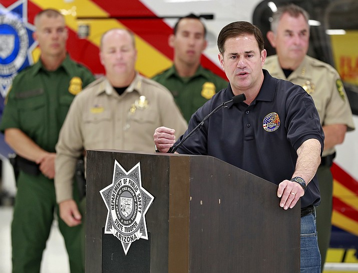 In this July 11, 2018, file photo, Arizona Gov. Doug Ducey, speaks at the Department of Public Safety aircraft hangar in Phoenix. The winner of Tuesday's three-way democratic primary will seek to replace Incumbent Ducey in the November general election. (Matt York/AP, File)