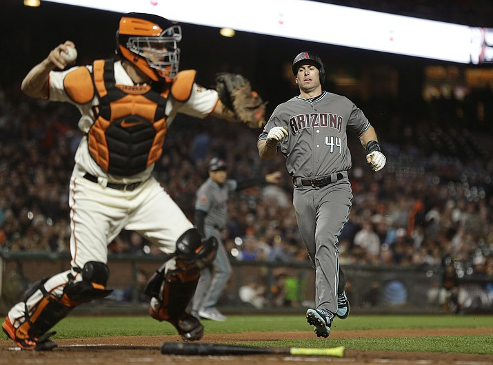Arizona Diamondbacks' Paul Goldschmidt, right, is forced out at home plate on a fielder's choice as San Francisco Giants catcher Nick Hundley throws the ball to first base in the sixth inning of a baseball game, Tuesday, Aug. 28, 2018, in San Francisco. The Diamondbacks' Ketel Marte was safe at first base on the play. (Eric Risberg/AP)