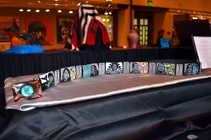 "The 2018 Best of Show winner at Santa Fe's prestigious Indian Market was an Elkhorn belt, priced at $50,000, made by Lakota artist Kevin Pourier. Titled ""Winyan Wanakiksin"", which means women defenders of others, the belt was an exquisitely detailed carved piece that took the entire summer to carve. (Photo/Rosanda Suetopka Thayer)"