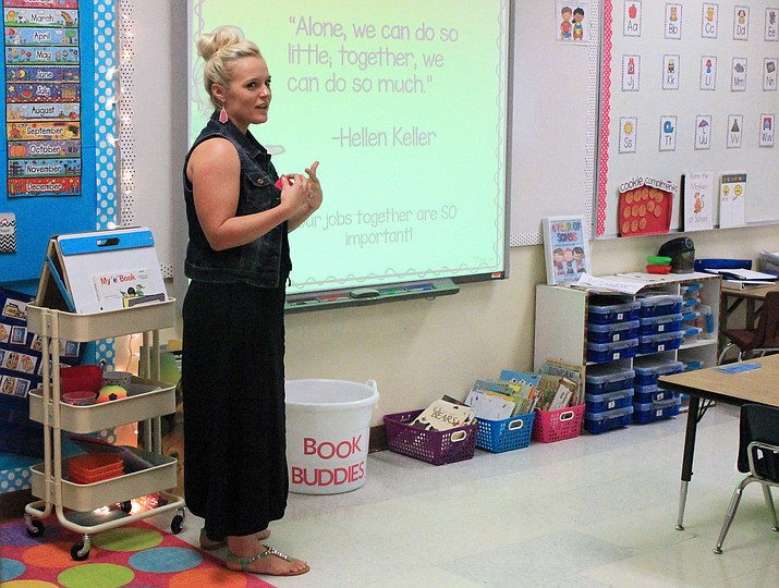 Kindergarten teacher Anna Hust addresses a group of parents at the Williams Elementary-Middle School open house Aug. 23.
