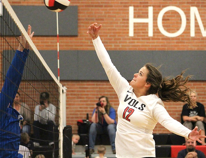 Lee Williams' Kalyse Whitehead finished with a team-high three blocks (two assisted, one solo) and notched three kills Tuesday against Kingman High. (Photo by Beau Bearden/Daily Miner)