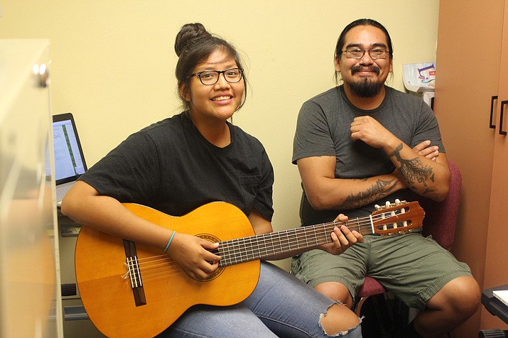 Native American composer Michael Begay shows Hopi High music student Christina Shupla how to compose for guitar. (Stan Bindell/NHO)