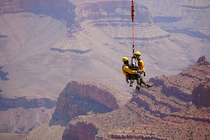 A short-hauler and simulated patient are extracted from a slope below the rim. (Photo/Grand Canyon Emergency Services)
