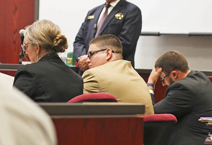 Derrick Barnett listens to the opening statement of lead prosecutor Ammon Barker at Coconino County Superior Court Aug. 21. Barnett is charged with first degree murder in the killings of Williams residents Michael and Nora DiMuria. The trial is expected to run through Sept. 21.