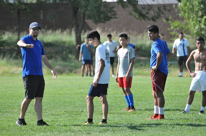 Chino Valley boys soccer head coach Todd Carey talks with his players during practice Aug. 15, 2018, in Chino Valley. (Doug Cook/Courier)
