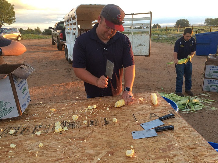 Chino Valley High School agriculture teacher Miles Holder chops the ends off of ears of corn to prepare them for the Saturday, Sept. 3, 2016, Corn Dinner. (Review file photo)