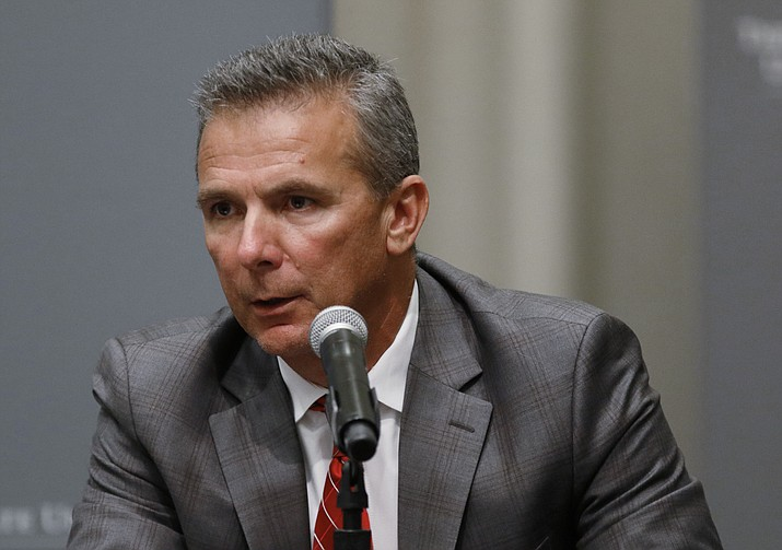 In this Aug. 22, 2018, file photo, Ohio State football coach Urban Meyer makes a statement during a news conference in Columbus, Ohio. Meyer's current suspension and previous paid leave have restricted him from talking football with his staff and athletes during August with one exception, a team meeting the day after the suspension was announced. Emails from the senior vice president for human resources show Meyer and athletic director Gene Smith were allowed to meet with the players and coaches last Thursday, Aug. 23, 2018. (Paul Vernon/AP, file)