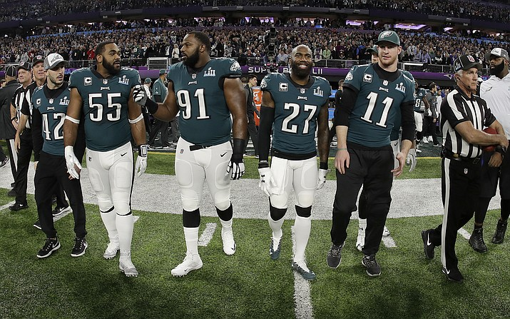 In this Feb. 4, 2018, file photo, Philadelphia Eagles' Chris Maragos, Brandon Graham, Fletcher Cox, Malcolm Jenkins and Carson Wentz, from left, walk to midfield before the NFL Super Bowl 52 football game against the New England Patriots in Minneapolis. Before they try to become the ninth team to repeat as Super Bowl champions, the Philadelphia Eagles will try to accomplish another tough task. Winning consecutive NFC East titles is so difficult it hasn't happened since the Eagles did it four straight seasons from 2001-04. (Matt Slocum/AP, file)