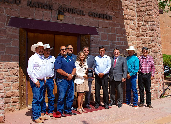 From left: Council Delegates Tom Chee, Leonard Pete, Raymond Smith, Jr., Seth Damon, former BIA Navajo Regional Director Sharon Pinto, Speaker LoRenzo Bates, Council Delegates Leonard Tsosie, Dwight Witherspoon, Tuchoney Slim, Jr., and Walter Phelps at the Navajo Nation Council Chamber in Window Rock Aug. 16 (Office of the Speaker)