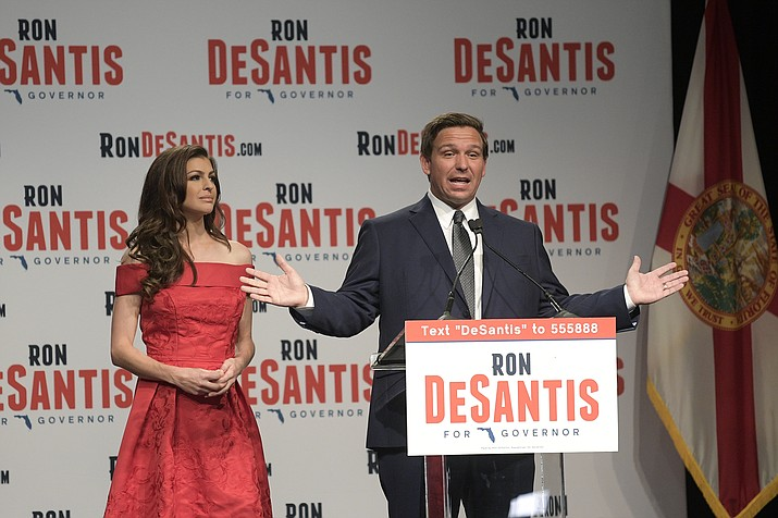 Florida Republican gubernatorial candidate Ron DeSantis, right, speaks to supporters with his wife Casey at an election party after winning the Republican primary Tuesday, Aug. 28, 2018, in Orlando, Fla. (Phelan M. Ebenhack/AP Photo)