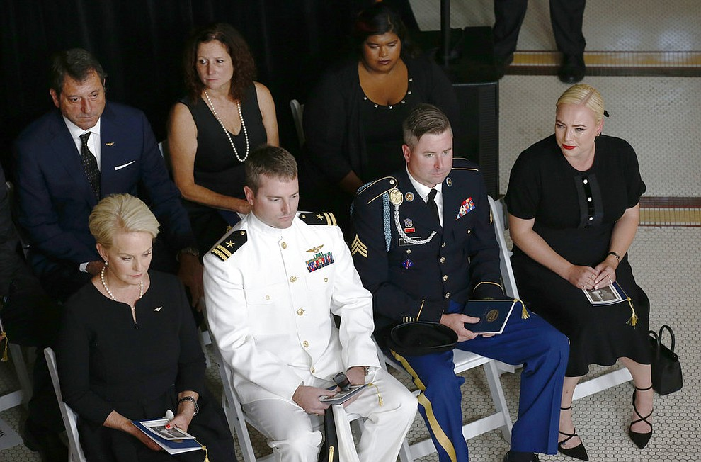 Cindy McCain, wife of Sen. John McCain, R-Ariz. sits with her sons Jack, Jimmy, and daughter Meghan, right, during a memorial service at the Arizona Capitol on Wednesday, Aug. 29, 2018, in Phoenix. (AP Photo/Ross D. Franklin, Pool)