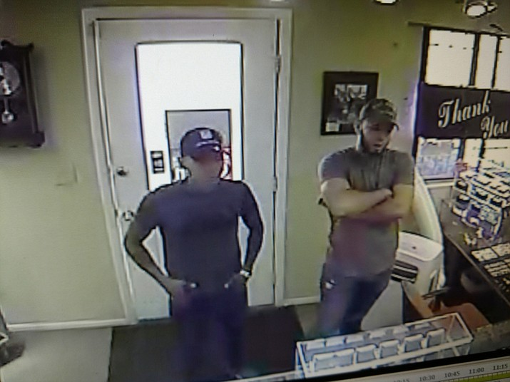 Police are seeking the identity of these two men captured on surveillance footage. The footage shows the men working together to steal $4,000 worth of jewelry from a business in Chino Valley.