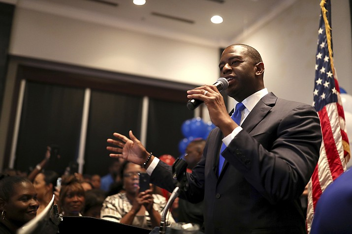 Democratic gubernatorial nominee Andrew Gillum celebrates his victory with supporters during his election watch party at Hotel Duval in Tallahassee, Fla., Tuesday, Aug. 28, 2018. (Joe Rondone/Tallahassee Democrat via AP)