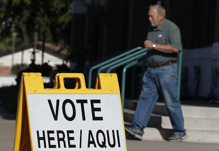 A man exits his polling station for voting in the Arizona primary, Tuesday, Aug. 28, 2018, in Tempe, Ariz. (Matt York/AP Photo)