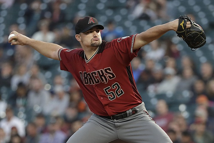 Arizona Diamondbacks pitcher Zack Godley throws to a San Francisco Giants batter during the first inning of a baseball game in San Francisco, Wednesday, Aug. 29, 2018. (Jeff Chiu/AP Photo)