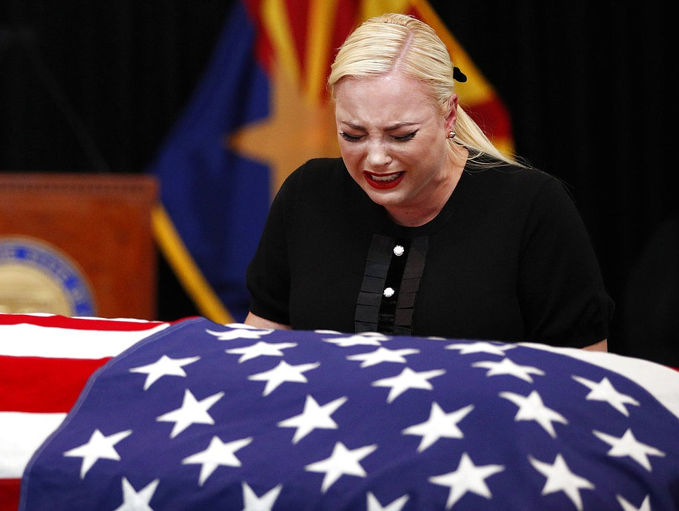 Meghan McCain, daughter of, Sen. John McCain, R-Ariz. cries at the casket of her father during a memorial service at the Arizona Capitol on Wednesday, Aug. 29, 2018, in Phoenix. (AP Photo/Jae C. Hong, Pool)