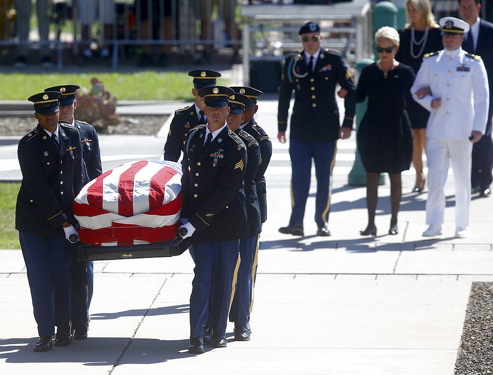 Cindy McCain, wife of Sen. John McCain, R-Ariz. arrives with her sons Jack, right, and Jimmy for a memorial service at the Arizona Capitol on Wednesday, Aug. 29, 2018, in Phoenix, (AP Photo/Ross D. Franklin, Pool)