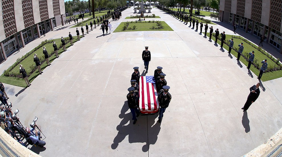 The Arizona National Guard carries the casket of Sen. John McCain, R-Ariz., into a memorial service at the Arizona Capitol on Wednesday, Aug. 29, 2018, in Phoenix. (Rob Schumacher/The Arizona Republic via AP, Pool)