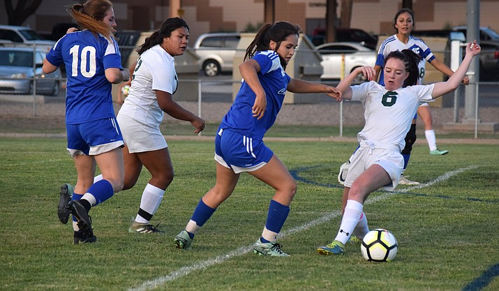 Camp Verde senior Tyra Smith dribbles past a Cougar during the Cowboys' 1-0 win over Show Low on Tuesday night at home. VVN/James Kelley