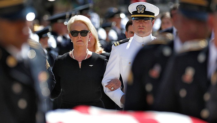 Cindy McCain, wife of, Sen. John McCain, R-Ariz., looks at the casket as it was carried into North Baptist Church in Phoenix Thursday. (Matt York/AP/johnmccain.com)