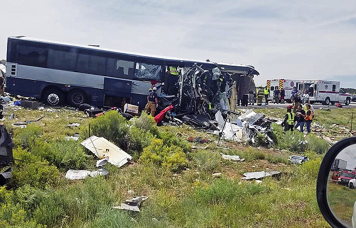 This photo provided by Chris Jones shows first responders working the scene of a collision between a Greyhound passenger bus and a semi-truck Thursday, Aug. 30, 2018, on Interstate 40 near the town of Thoreau, N.M., near the Arizona border. Multiple people were killed and others were seriously injured. (Chris Jones via AP)
