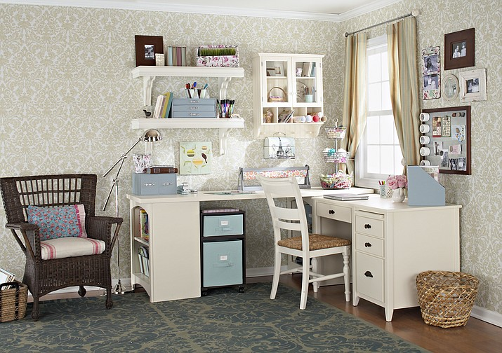 This photo show a workspace setup in a bedroom. It's perfectly fine to use your child's room when they're away at school. If you're using a desk, be sure to safely store your child's belongings while you're using the workspace. (Better Homes & Gardens via AP)