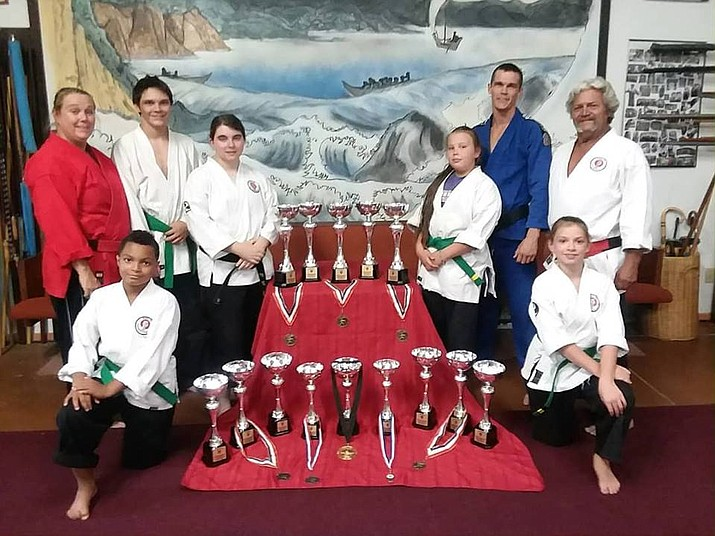 LeDanian Brubaker, Shihan Lori Morris, Cosmo Morris, Sensei Danielle Hamilton, Makenzee Morris, Shihan Alex Morris, Kyoshi James Morris and Cheyenne Pehl pose for a photo after claiming six titles at the 2018 USAMA World Championships Aug. 3-5 in Riverside, California. (Shihan Lori Morris/Courtesy)