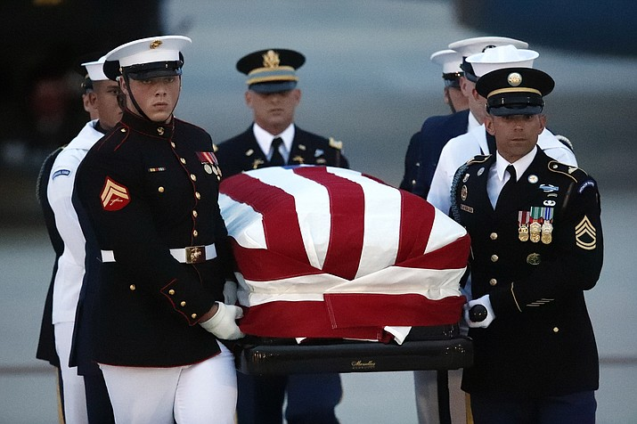 The flag-draped casket of Sen. John McCain, R-Ariz., is carried by an Armed Forces body bearer team to a hearse, Thursday, Aug. 30, 2018, at Andrews Air Force Base, Md. (Alex Brandon/AP Photo)