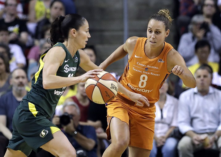 Seattle Storm's Sue Bird, left, tries to drive past Phoenix Mercury's Stephanie Talbot in the first half in a WNBA basketball playoff semifinal Tuesday, Aug. 28, 2018, in Seattle. (Elaine Thompson/AP Photo)