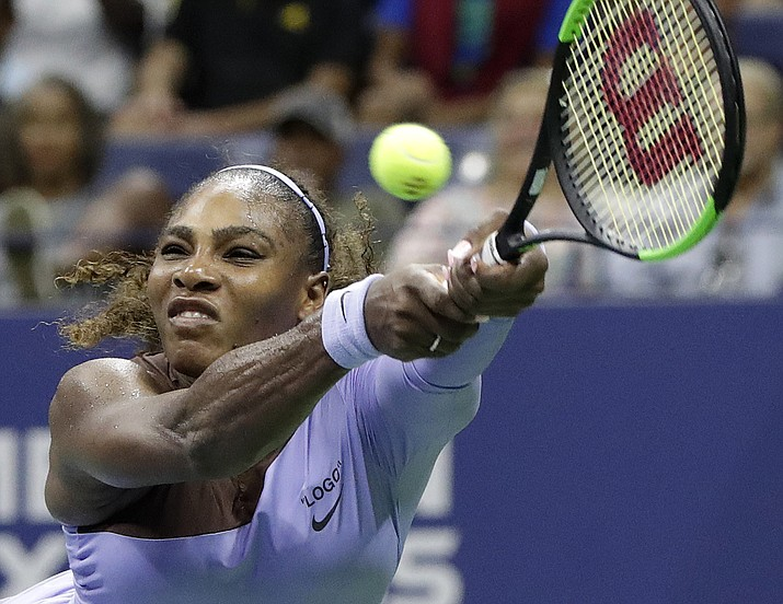 Serena Williams returns a serve by Carina Witthoeft, of Germany, during the second round of the U.S. Open tennis tournament, Wednesday, Aug. 29, 2018, in New York. (Julio Cortez/AP Photo)