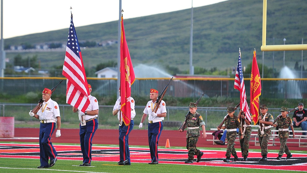 A Marine Corps and Young Marine color guard present the colors before Bradshaw Mountain take on the Youngker Roughriders in their home opener Friday, August 31, 2018 in Prescott Valley. (Les Stukenberg/Courier)