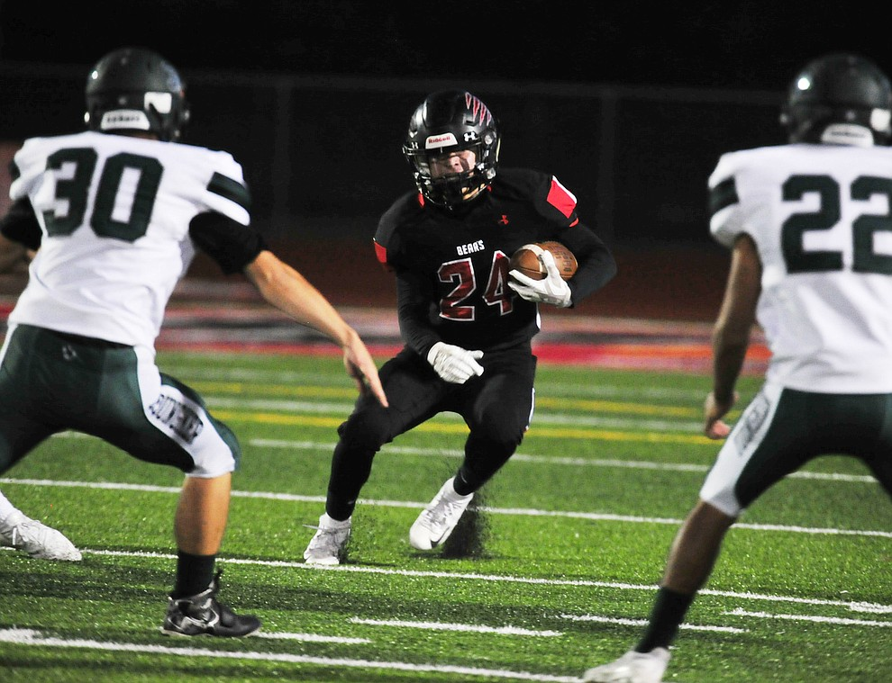 Bradshaw Mountain's Victor Arenas (24) looks for running room as the Bears take on the Youngker Roughriders in their home opener Friday, August 31, 2018 in Prescott Valley. (Les Stukenberg/Courier)