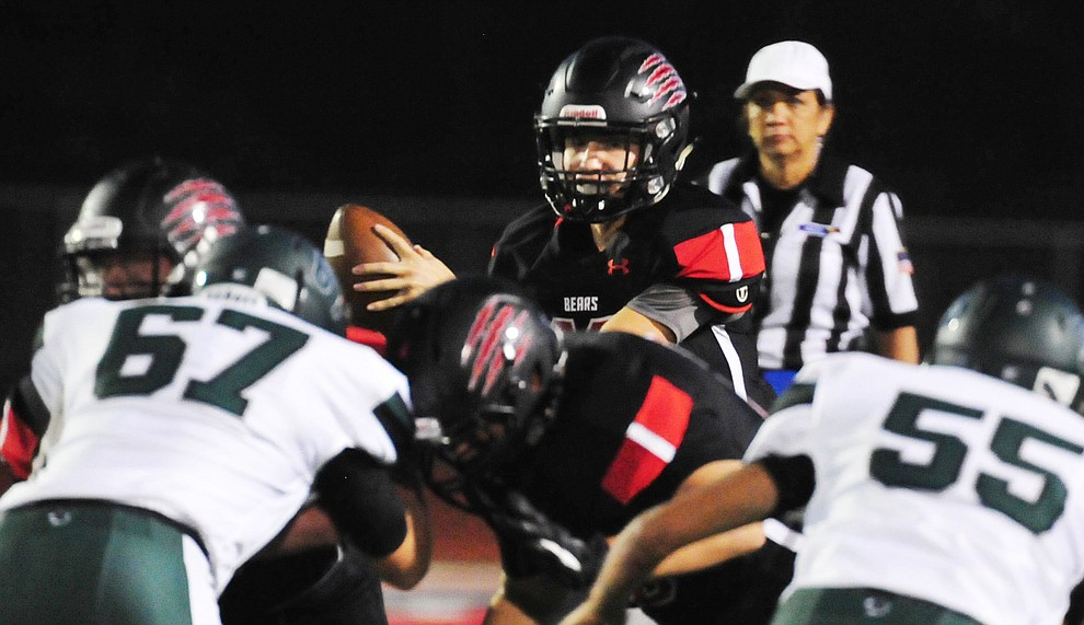 Bradshaw Mountain's Austin Gonzales (13) takes the snap as the Bears take on the Youngker Roughriders in their home opener Friday, August 31, 2018 in Prescott Valley. (Les Stukenberg/Courier)