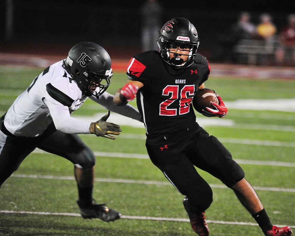 Bradshaw Mountain's Anthony Mata (26) runs to the sideline and a big gain as the Bears take on the Youngker Roughriders in their home opener Friday, August 31, 2018 in Prescott Valley. (Les Stukenberg/Courier)