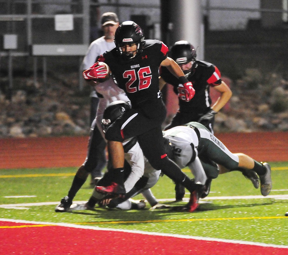 Bradshaw Mountain's Anthony Mata (26) hits the end zone for a score as the Bears take on the Youngker Roughriders in their home opener Friday, August 31, 2018 in Prescott Valley. (Les Stukenberg/Courier)